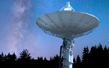 Space technology demonstrated through a large ground station pointed at the night sky