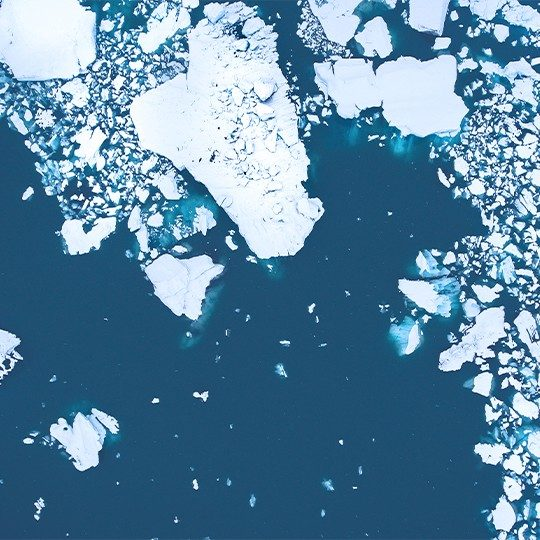 Aerial view of chunks of ice floating in the arctic