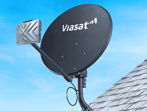 Viasat branded satellite dish with TRIA mounted to a rooftop