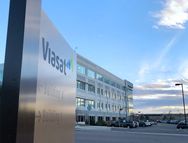 Angled view of the Viasat entrance sign in front of building 1 in Denver, CO