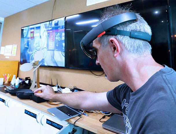 Viasat engineer tests out virtual equipment in a lab