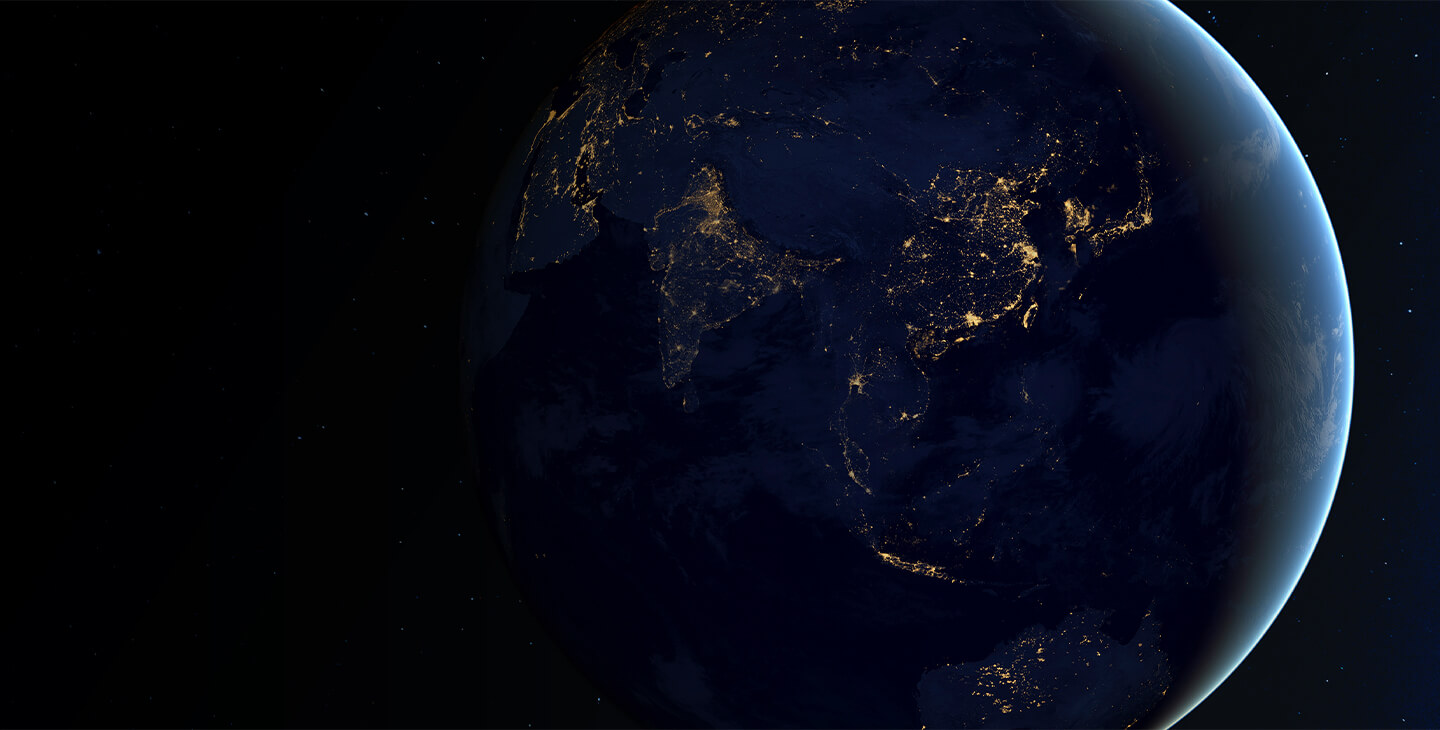Aerial view of the Earth at night with city light aglow, demonstrating Viasat's global reach