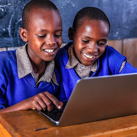 students connecting globally on laptop