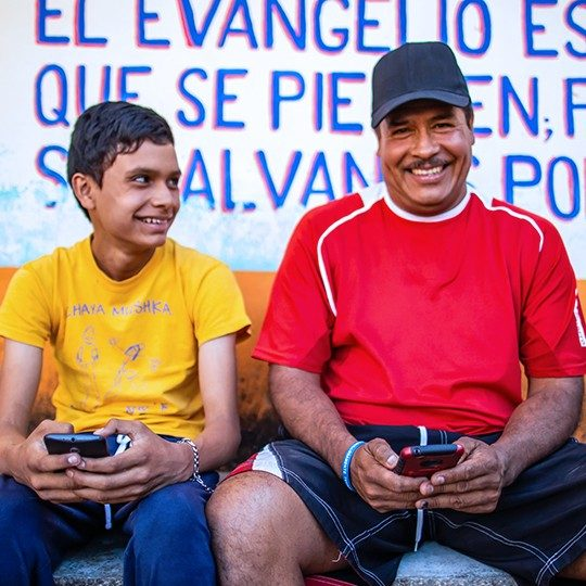 father and son connecting globally on mobile