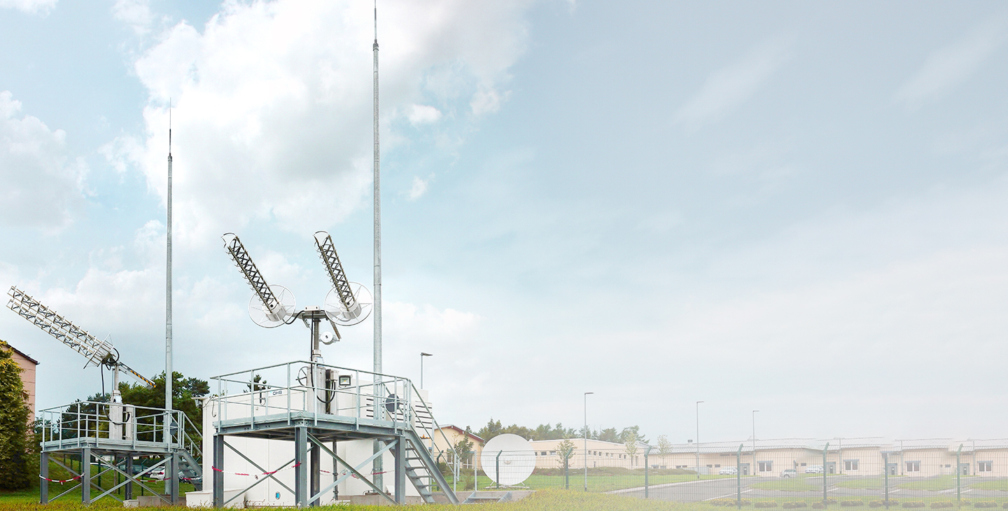 Two UHF SATCOM terminals mounted on top of metal platforms
