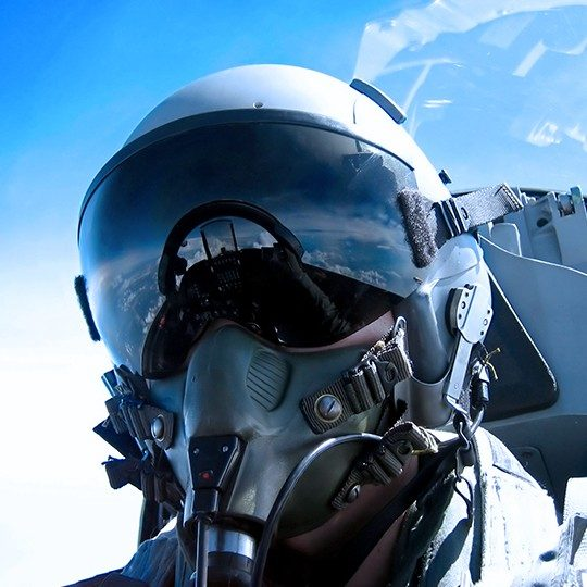 Fighter pilot utilizing airborne communication systems