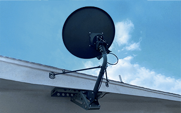 An under-eave mount example with a Viasat satellite dish installation
