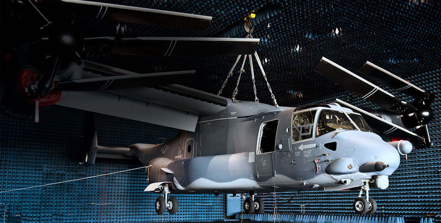 Gray helicopter hanging from the ceiling of an anechoic chamber